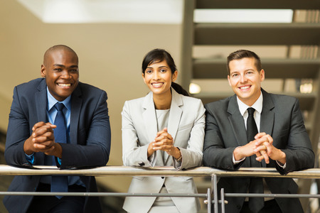 group of multiracial business people standing by stairway Stock Photo