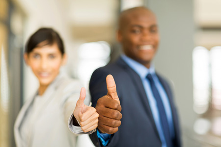co workers: close up of business team thumbs up