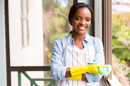 house chores: portrait of pretty african woman doing house chores Stock Photo