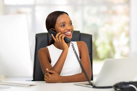 fashionable woman: attractive african american businesswoman using landline phone Stock Photo