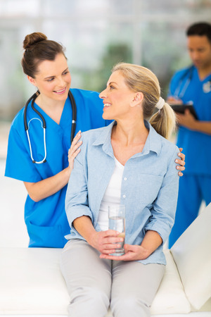girl care: happy senior patient talking to friendly female nurse
