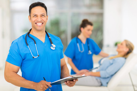 happy mid age medical professional in office photo