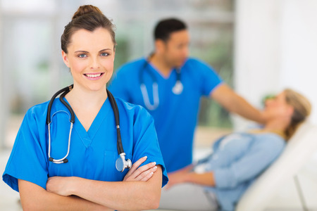 attractive young female medical worker in office photo