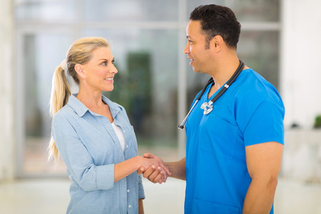 caring medical doctor greeting senior patient photo