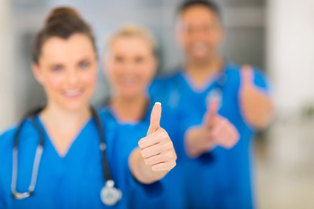 thumbs up group: group of successful hospital staff thumbs up Stock Photo