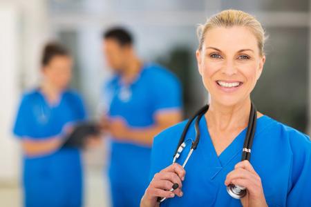mid adult   female: cheerful mid age female nurse in hospital
