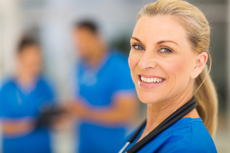 portrait of confident senior medical doctor photo