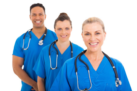 white work: confident senior medical doctor and colleagues