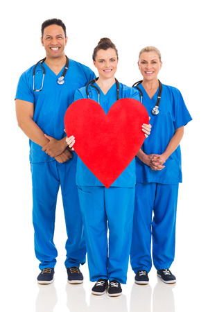 healthcare workers: group of healthcare workers with heart symbol isolated on white background Stock Photo