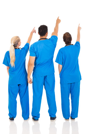 rear view of medical doctors pointing empty space photo