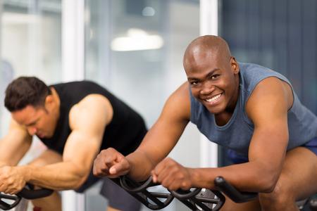 healthy lifestyles: healthy men on gym bike Stock Photo