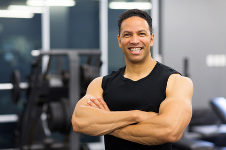 middle age man: portrait of mid age male gym trainer
