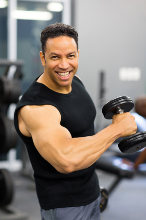 mid age: fit mid age man training with dumbbell