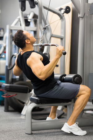 bodybuilder working out at the gym