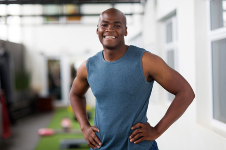 african american male: fit young african man looking at the camera in gym Stock Photo