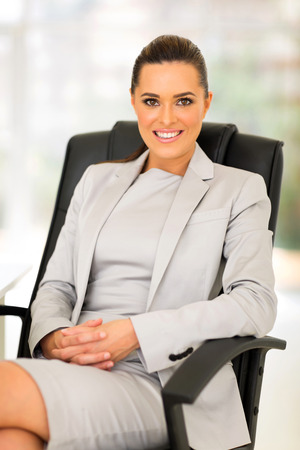 beautiful young career woman sitting in office