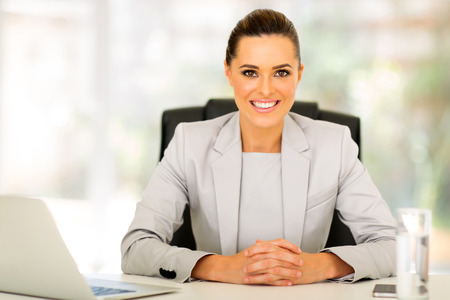 attractive young office worker sitting in office