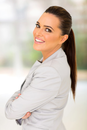cheerful young career woman in office