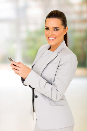 white suit: pretty young businesswoman using smart phone Stock Photo
