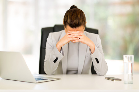 sleep well: stressed businesswoman sitting in office