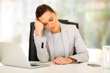 sleep well: beautiful young business woman sleeping in office