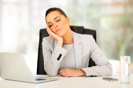 sleep well: tired businesswoman sleeping in office