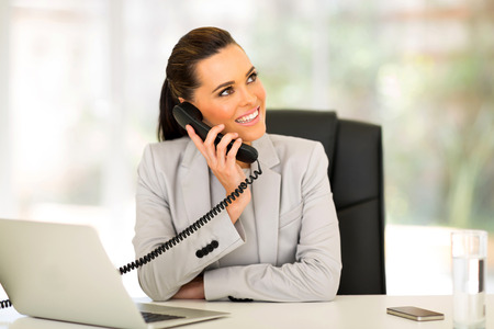phone conversations: gorgeous office worker talking on telephone