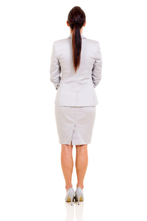 woman back view: back view of young businesswoman isolated on white background Stock Photo