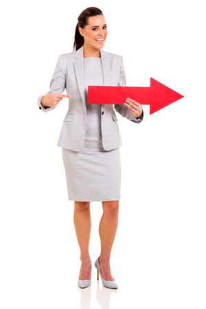 happy businesswoman pointing red arrow symbol isolated on white photo
