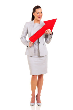 attractive businesswoman holding red arrow isolated on white photo
