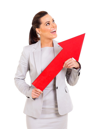 cheerful young businesswoman holding direction arrow pointing up photo