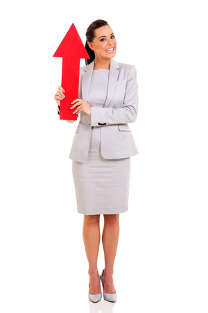 beautiful woman holding red arrow pointing up isolated on white photo