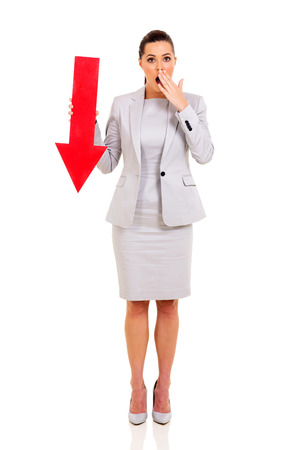 surprised business woman with arrow pointing down isolated on white photo