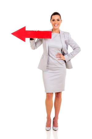 pretty businesswoman with red direction arrow on white background photo
