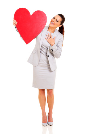 portrait of happy businesswoman with heart shape against white background Stock Photo