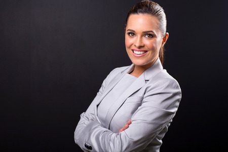 close up portrait of business woman isolated on black background