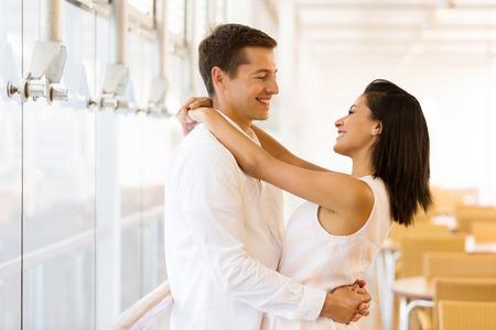 lovely couple: lovely couple hugging in restaurant