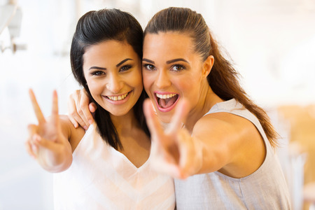 friend hug: cheerful two young friends having fun Stock Photo