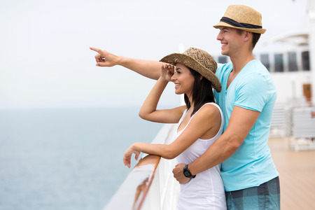 adult cruise: romantic couple on a cruise ship and pointing Stock Photo