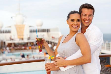 adult cruise: happy caucasian couple having fun on cruise trip