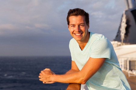 happy young man: portrait of happy young man enjoying cruise