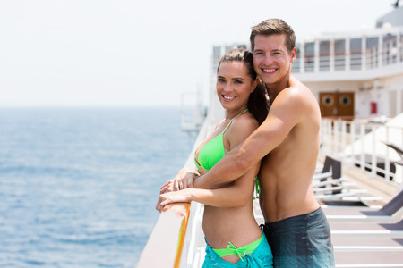 bikini couple: happy young couple on summer holiday on a cruise ship
