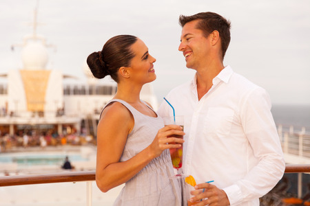 adult cruise: lovely young couple on summer vacation on a cruise Stock Photo