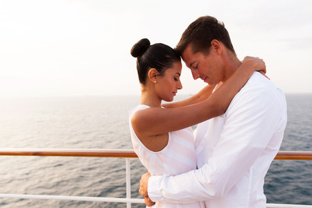 eye's closed: beautiful young couple hugging with eyes closed on a cruise ship