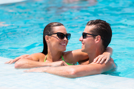 loving young couple relaxing in swimming pool photo