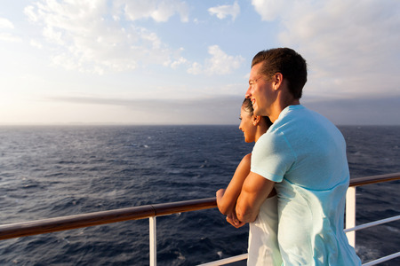 happy couple enjoying sea view in the morning on a cruise ship