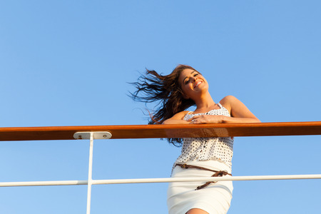ferries: low angle view of woman on cruise looking at the camera