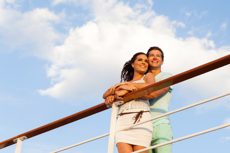 adult cruise: attractive happy couple looking away on a cruise ship Stock Photo