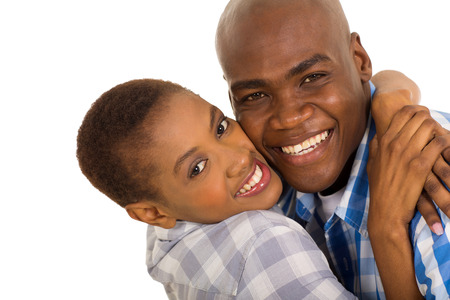 closeup portrait of happy african american couple hugging photo