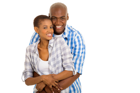portrait of cute young african couple embracing photo
